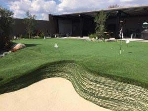 artificial grass putting green with stacked sod bunker