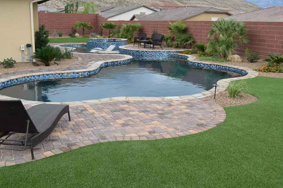 Swimming Pool Artificial Turf : Swimming pools with artificial grass around them