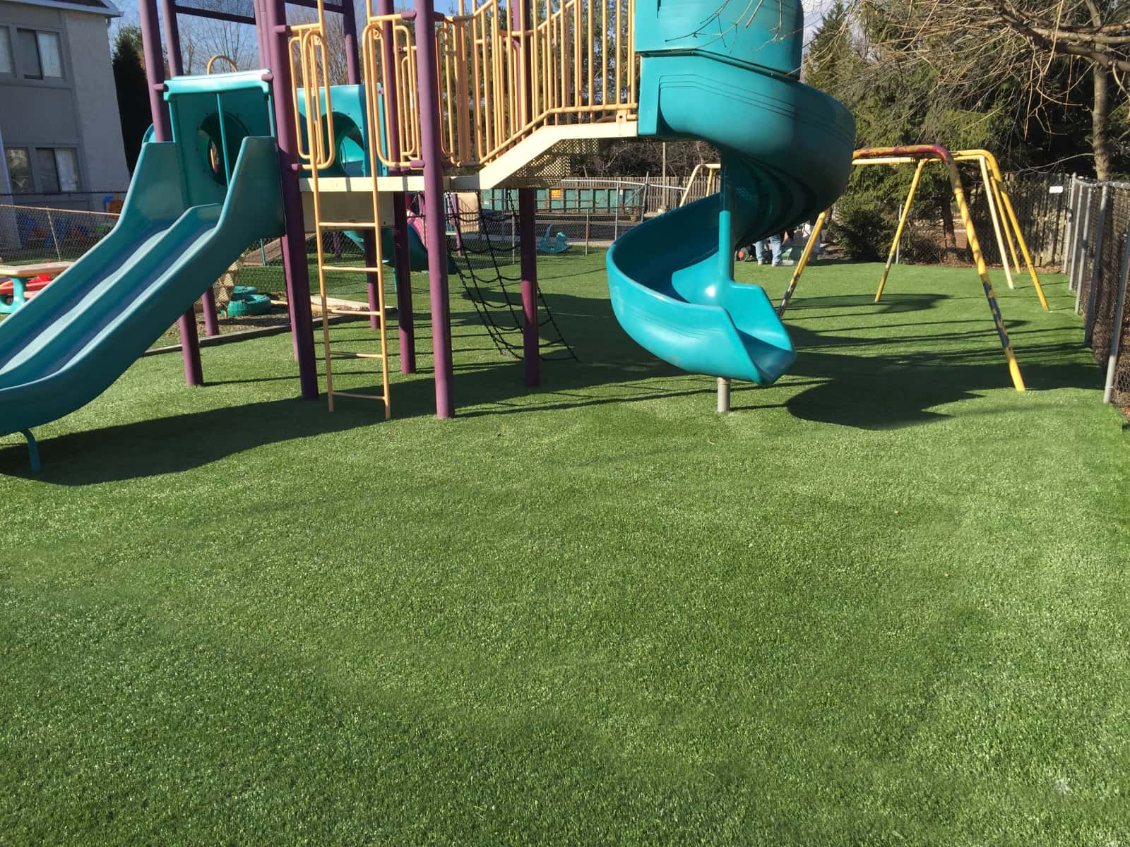 Playground with artificial grass padded ground