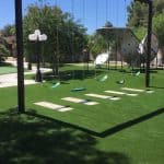 backyard playground with artificial grass
