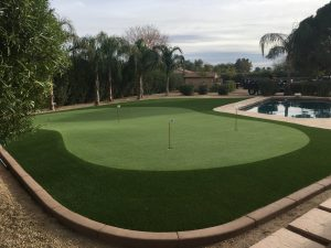 beautiful drought resistent synthetic grass backyard putting green