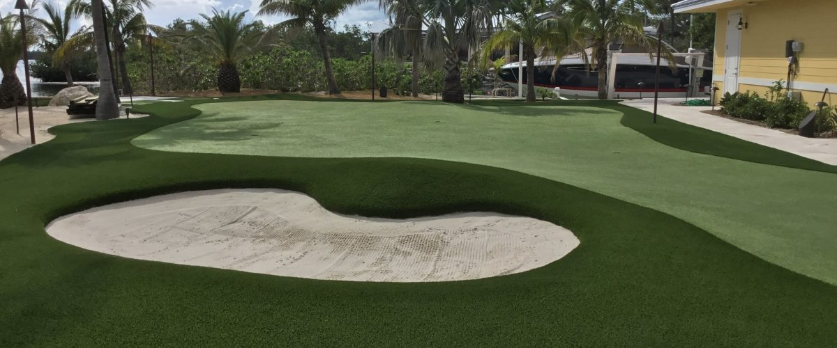 FL backyard putting green with white sand bunker