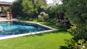 Artificial Grass surrounding backyard pool