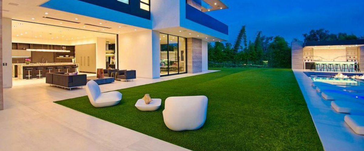 modern home with synthetic turf grass lawn