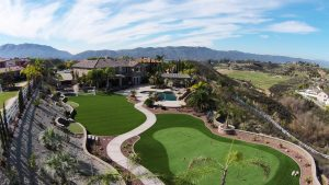 overhead view of private estate with synthetic turf lawn and putting green