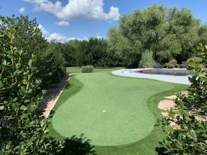 custom backyard putting green with synthetic turf