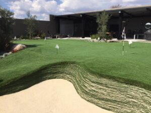 backyard putting green with stacked sod bunker