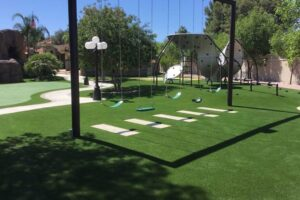 large backyard artificial grass lawn with swingset